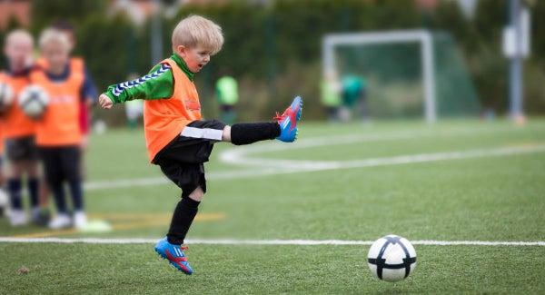 https://www.atlasepirusfc.gr/wp-content/uploads/2020/11/boy-kicking-soccer-ball.jpg